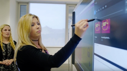 Woman uses Surface Pen on a Surface Hub at the City of Edinburgh Council in Scotland.