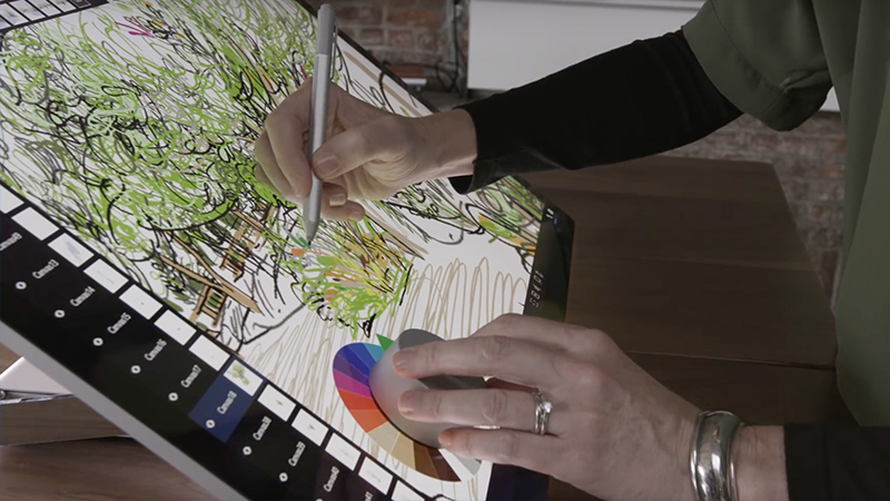 Person uses Mental Canvas software with Surface Dial and Surface Pen on Surface Studio.