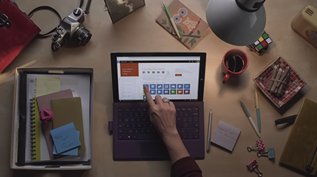 Depiction of Office helping protect systems from threats, play in-page video about Office 365 Real-Time Advanced Threat Protection