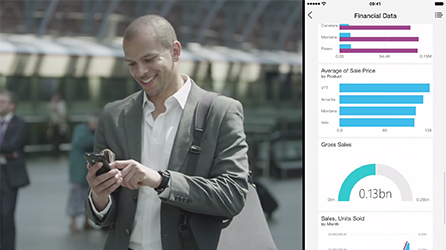 A man looking at his smartphone with split screen showing a phone screen, play in-page video about Power BI features