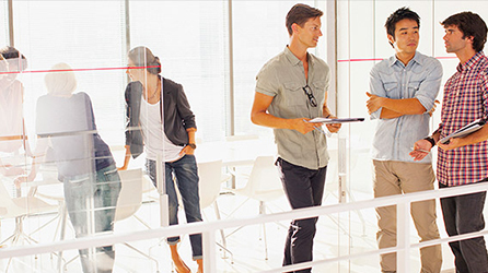 Coworkers talking together in a conference room, read article about Your digital transformation starts here