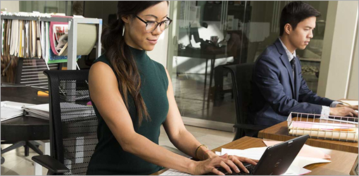 Man and woman working in office, learn more about Office 2007 and how you can upgrade to Office 365