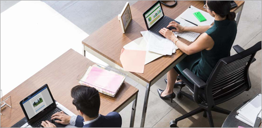 Overhead view of people working in an office, learn more about Office 2013 and how you can upgrade to Office 365