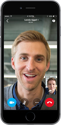 A phone screen showing two men talking to each other using Skype for Business app for mobile devices