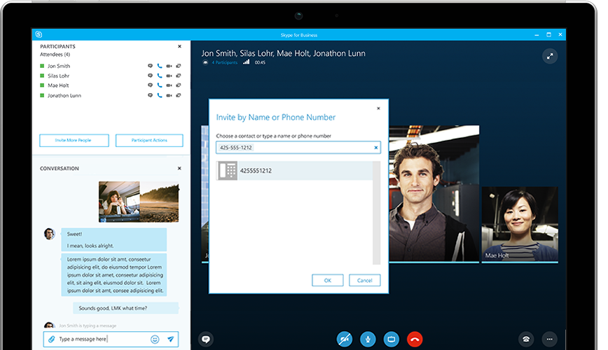 A person typing on a Surface tablet, with a Skype for Business online meeting appearing on the screen