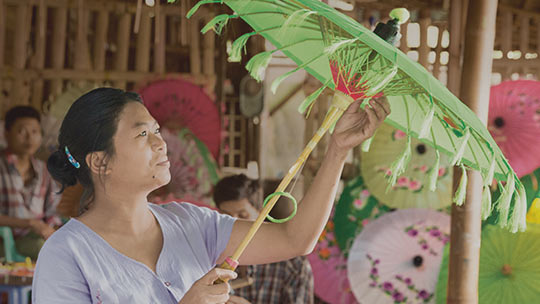 Woman with parasols, learn how Temenos lowered the cost of borrowing