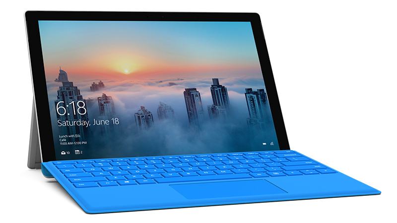 Bright blue Surface Pro 4 Type Cover attached to Surface Pro device, diagonal view, with city screenshot