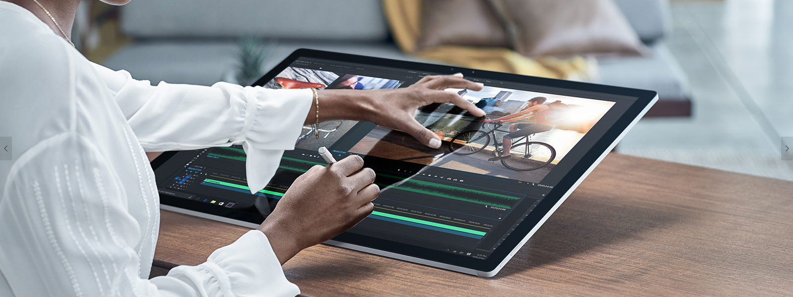 Woman using Surface Studio pinch zooming with Pen and touch.