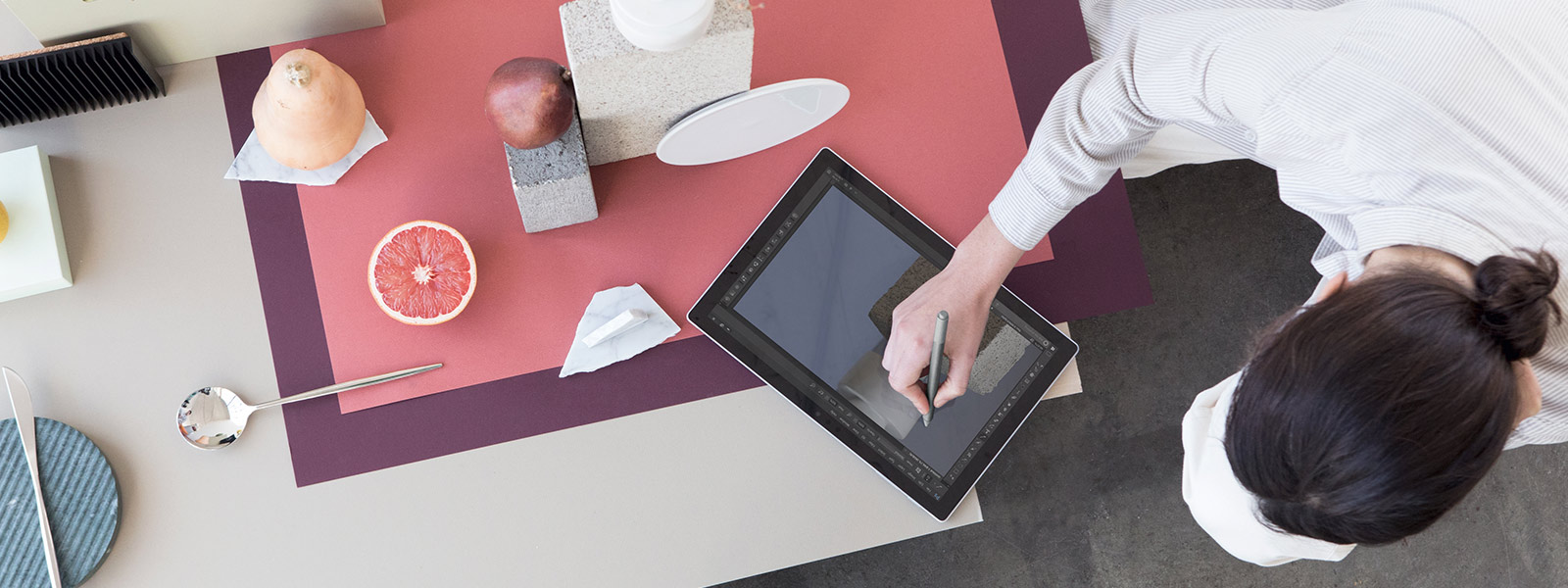 Man lounging while using Surface Pro touchscreen.