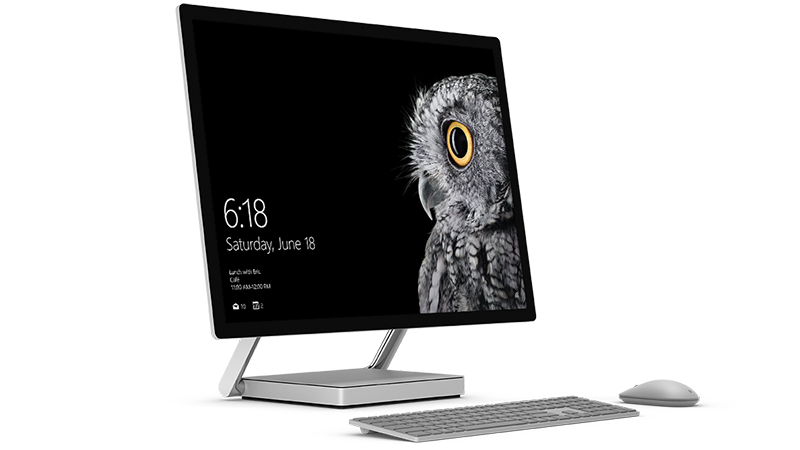 Surface Studio in upright position with mouse and keyboard.
