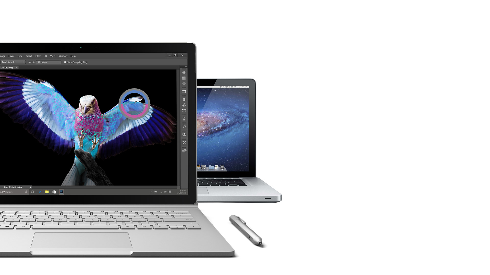 Surface Book open facing front with Surface Pen and a MacBook Pro in the background
