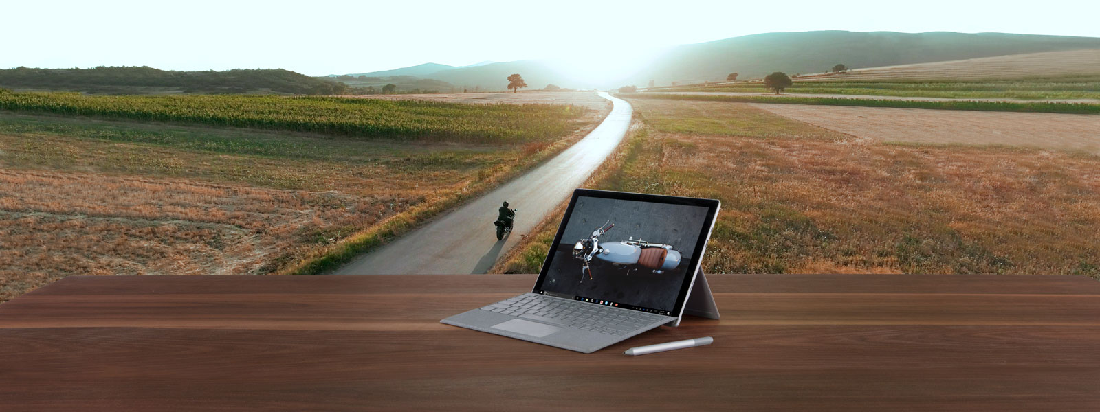 Surface Pro with a motorcycle in the background.