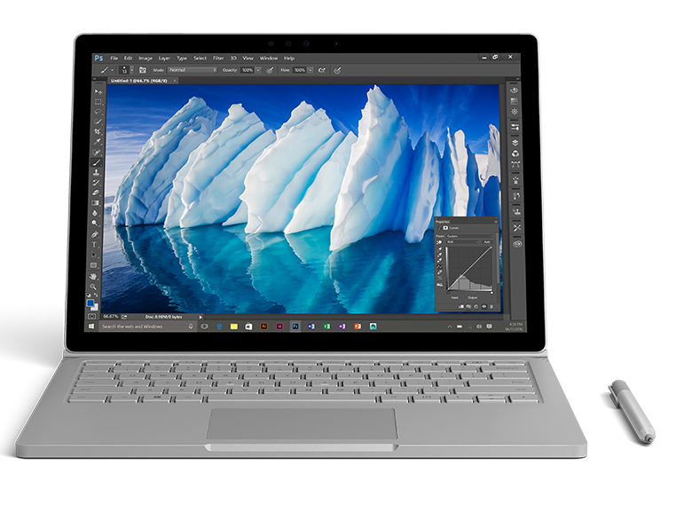 Surface Book with pen showing a high resolution image of an iceberg on screen.