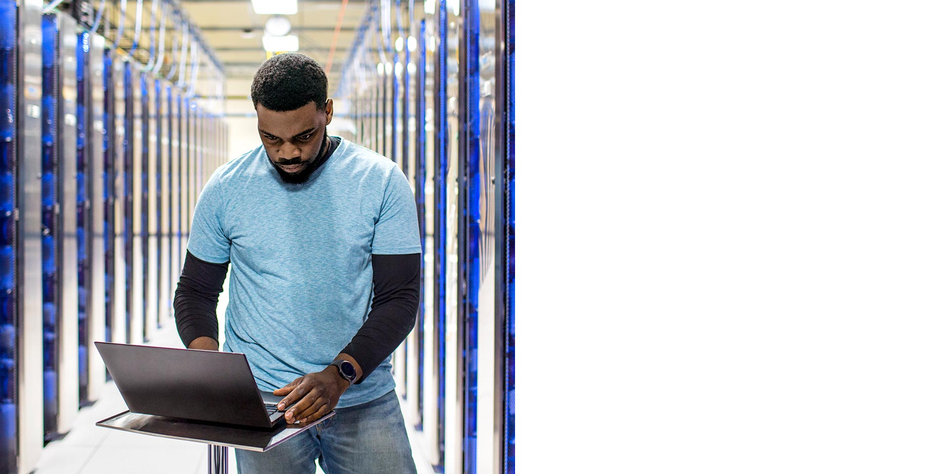 Man using a laptop in a data centre