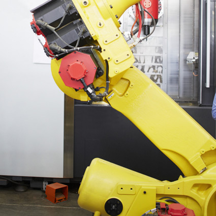 Mechanical robot arm in a factory