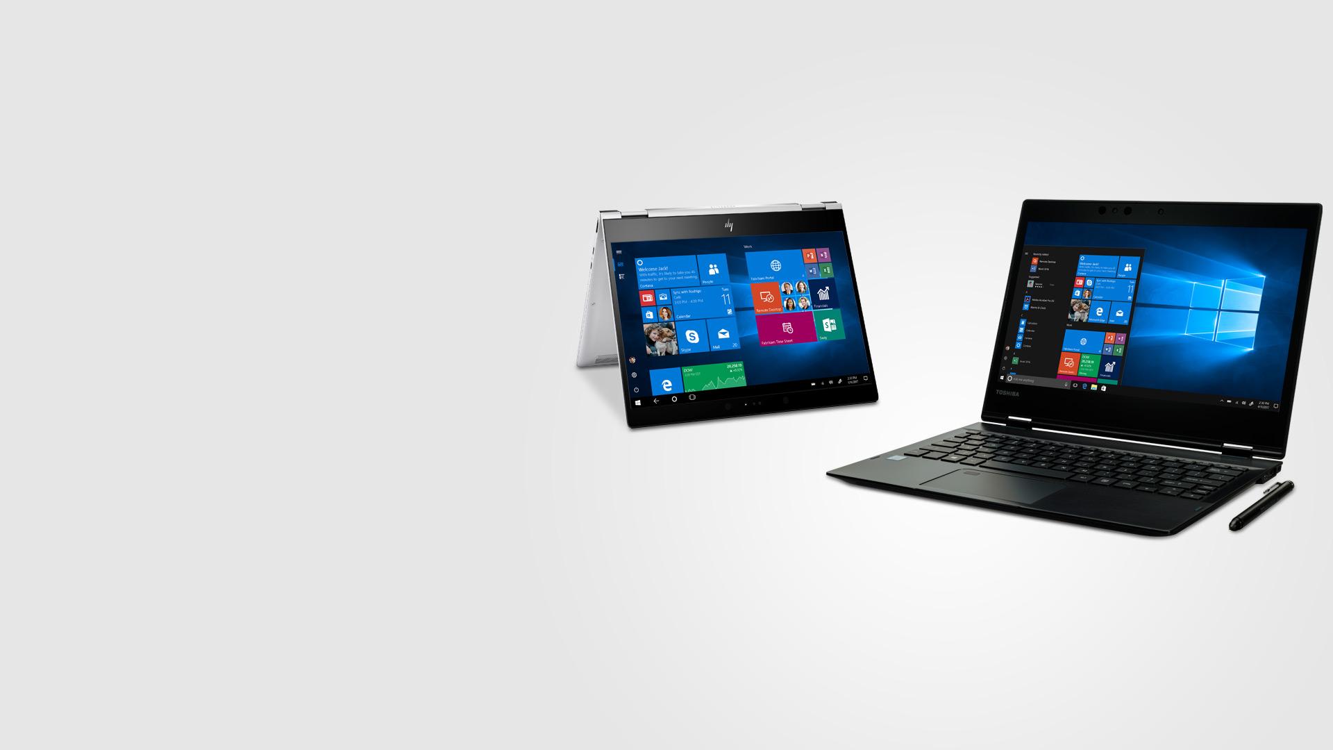 Two Windows 10 Pro laptops displaying Windows 10