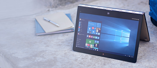 A Windows 10 PC in tent mode showing built in apps and start menu