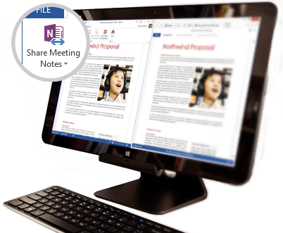 A desktop monitor with shared meeting content displayed.