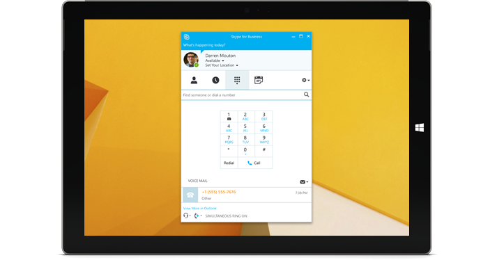 A Windows tablet with a Skype for Business dial view.