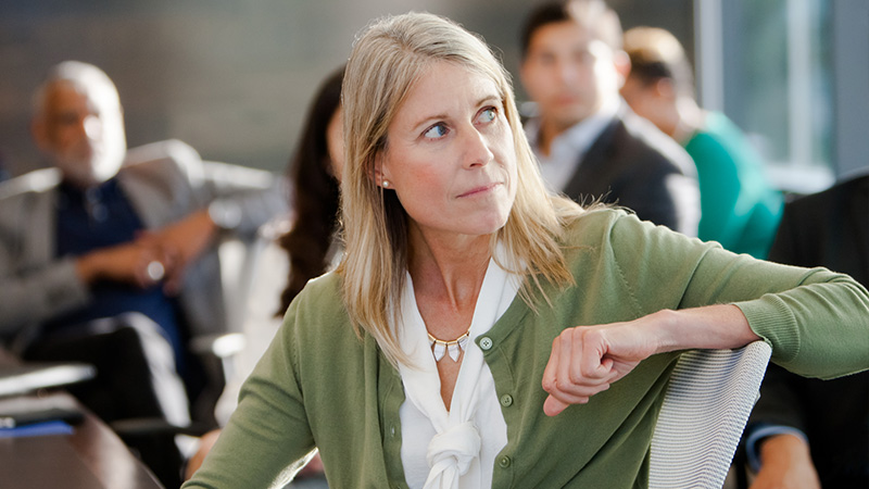 A woman in a business context listening to something