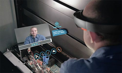 Technican using Microsoft HoloLens at his job