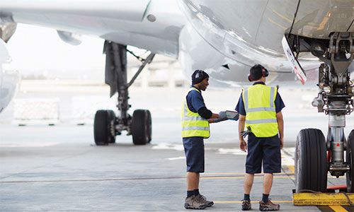 Two man standing in front of an aircraft