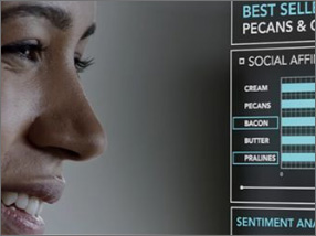 Part of womans face on the left and charts on the right