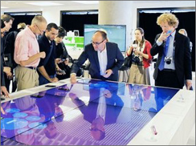 People around interactive table working