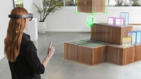 Woman with virtual reality headset designing a room