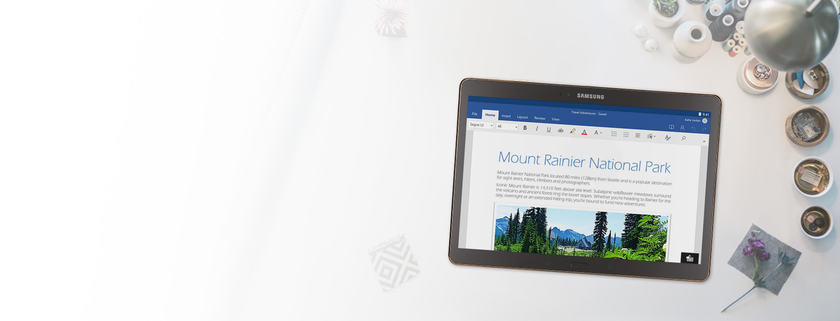 A tablet displaying a Word document about Mount Rainier National Park