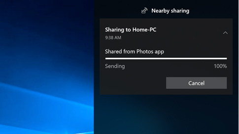 The new Nearby Sharing window showing status of sharing at 100% from Photos app