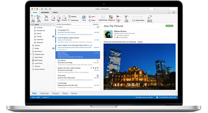 A MacBook showing an inbox in Outlook for Mac.