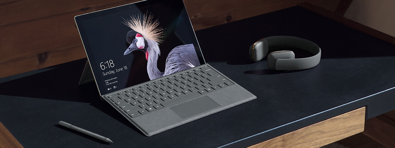 Image of Surface Pro Signature Type Cover placed on top of a desk.