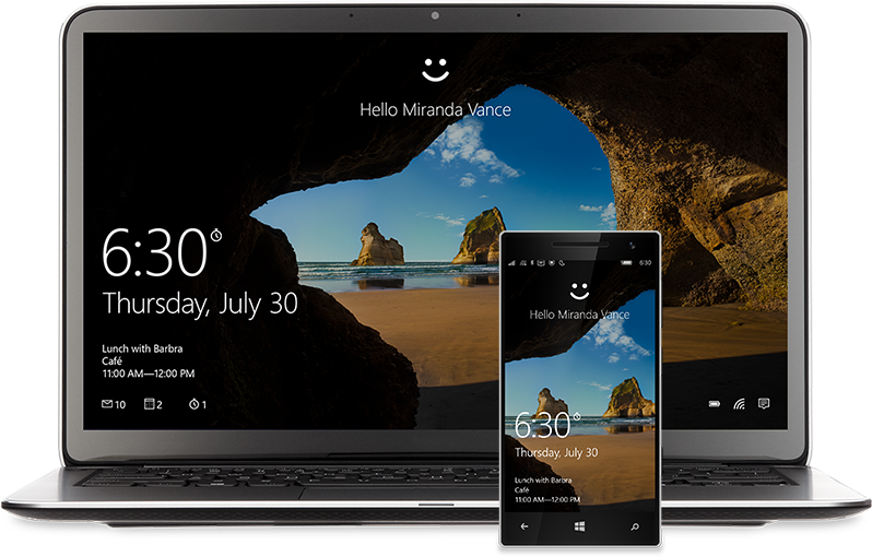 """A laptop and phone with the Windows10 Start screen on the display. There's a smiley face at the top of each above the words, """"Hello Miranda Vance"""""""