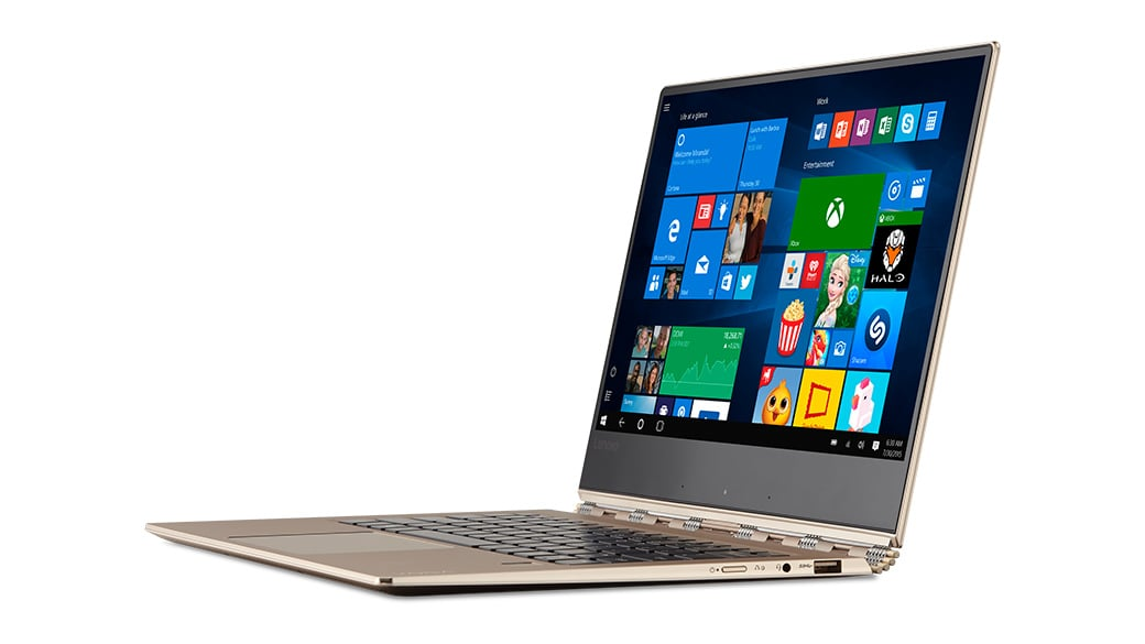 Laptop open with Windows screen displaying app tiles