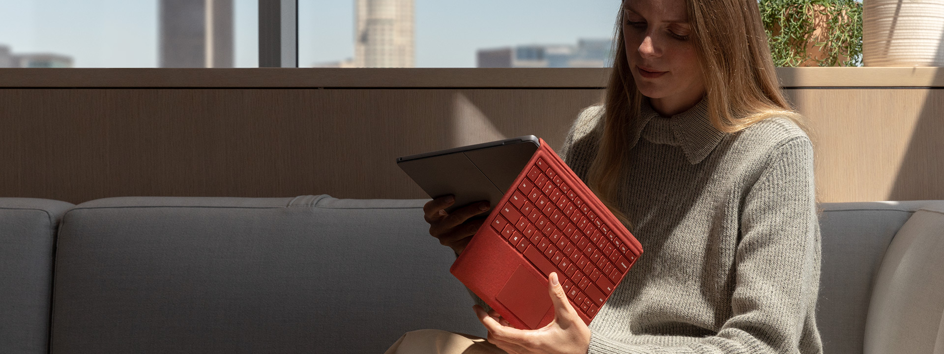 Person using Surface Pro 7 on the sofa