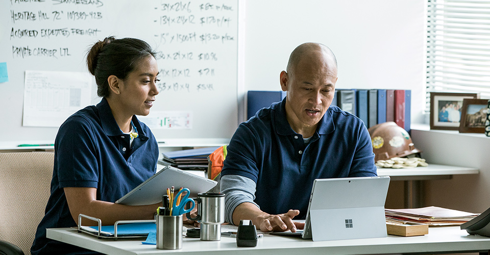 A man and woman working together in an office