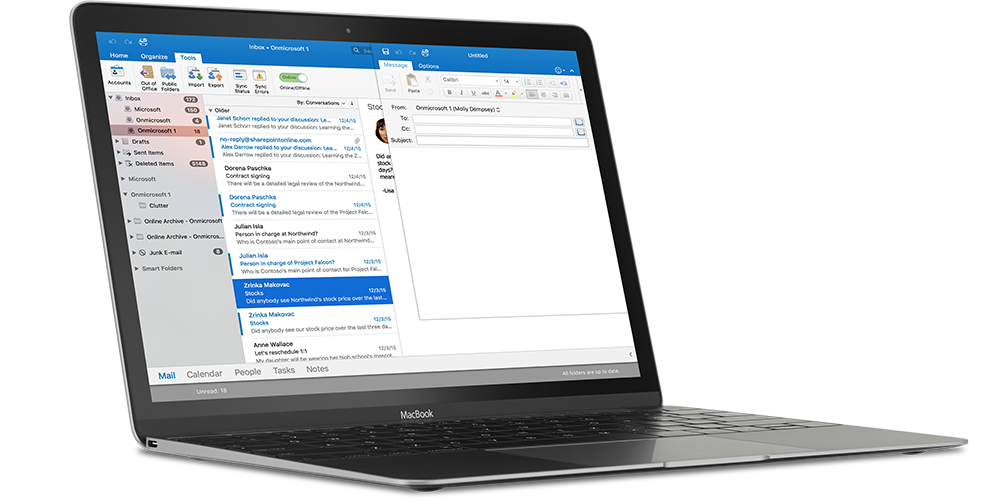A MacBook displaying an email inbox in Outlook for Mac