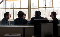 view into a meeting room with employees talking
