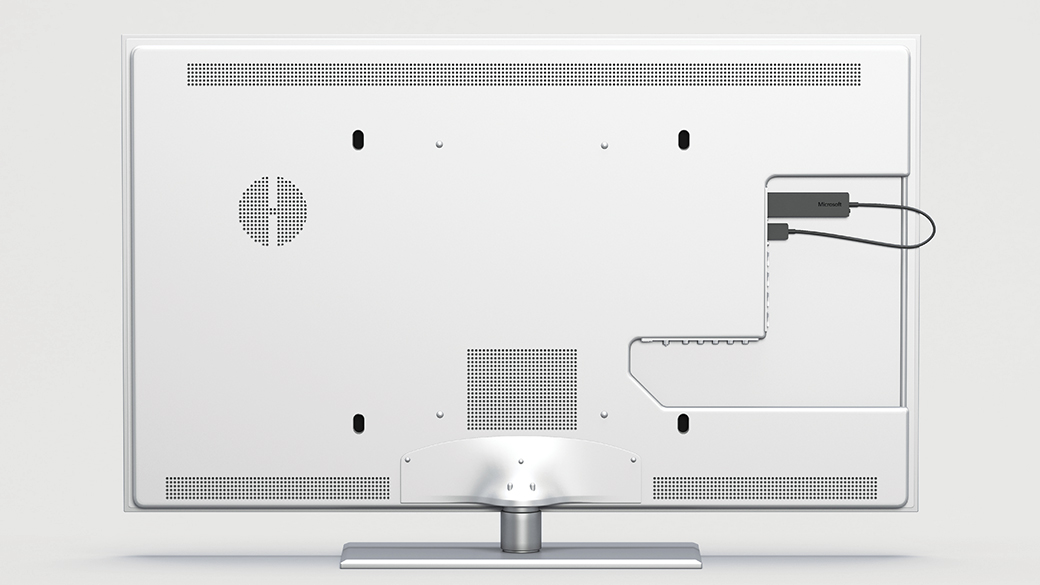 Detailed image of the Wireless Display Adapter connected to the back of the monitor.