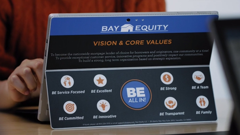 Bay Equity Home Loans sticker on the back of a Surface Pro 4.