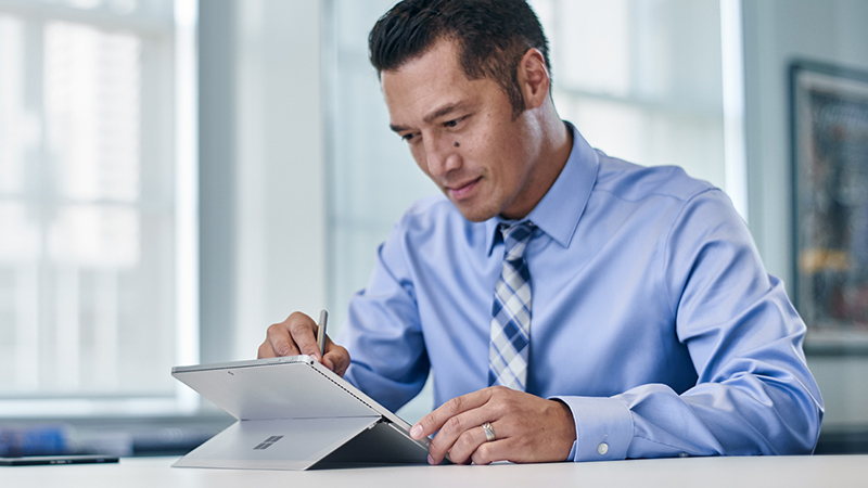 Man typing on Surface Book