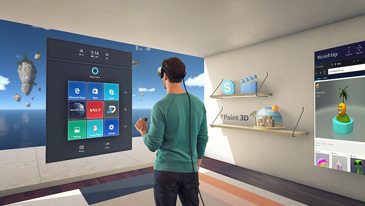 Man wearing headset standing in room with 3D UI and elements layered on the walls