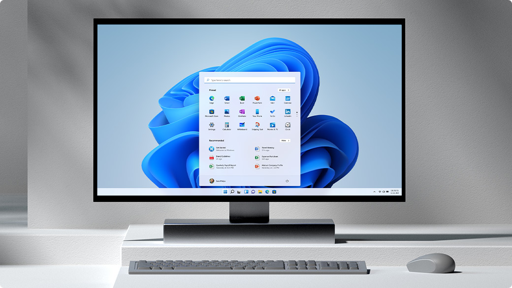 Windows PC with dialog box and bloom in background and mouse sitting on a table