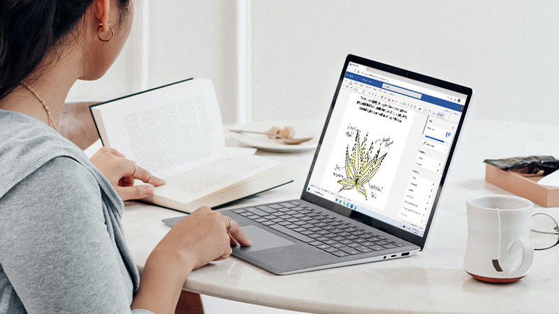 A student using a Windows 10 computer to make a word document