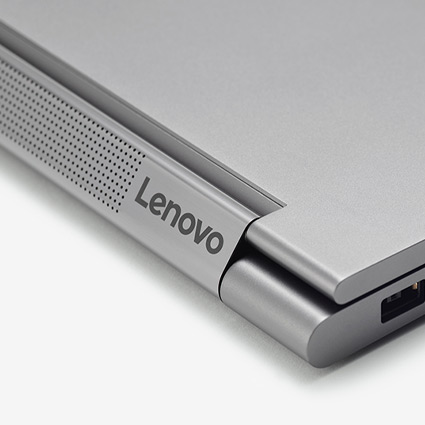 "Back right corner of a laptop with ""Lenovo"" logo displayed"