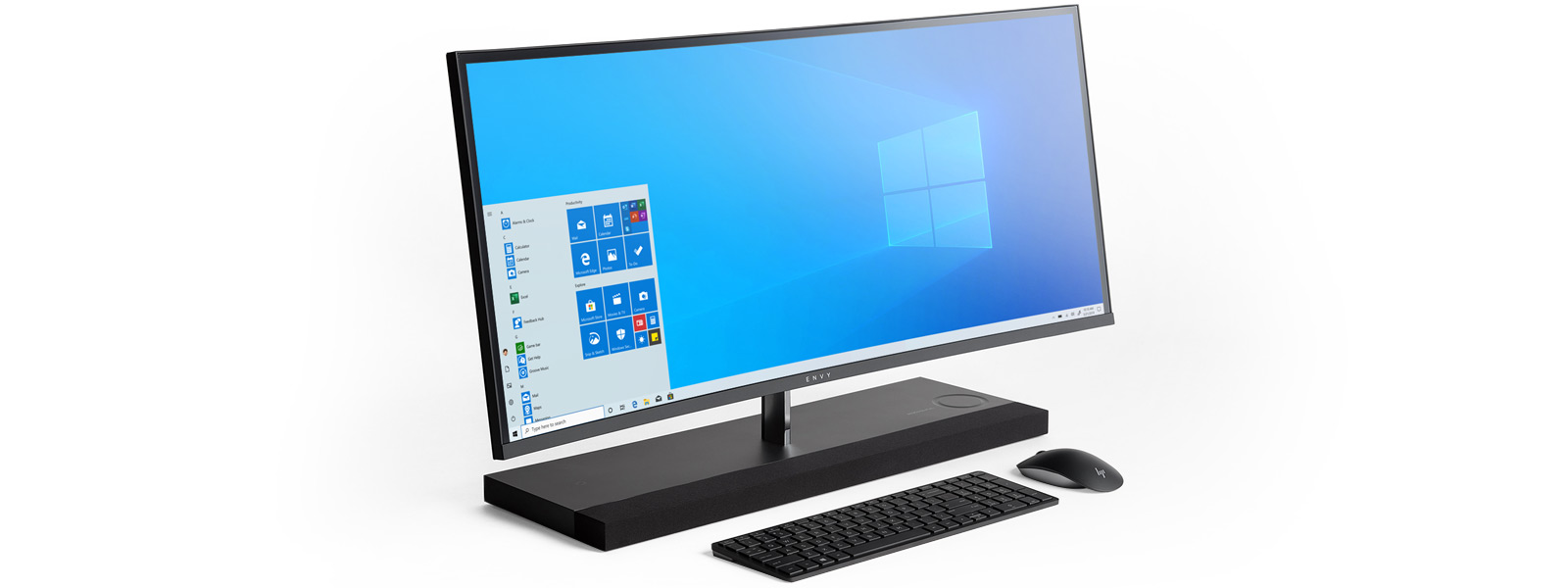 An HP ENVY 27 all in one computer showing a Windows 10 start screen with a keyboard and mouse in front of it