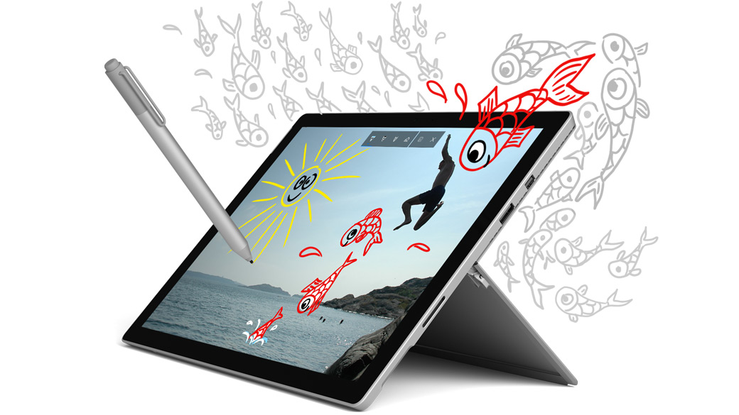 A Surface Pro, angled left, and Surface Pen with decorative drawings of fish surrounding and emerging from the edge.