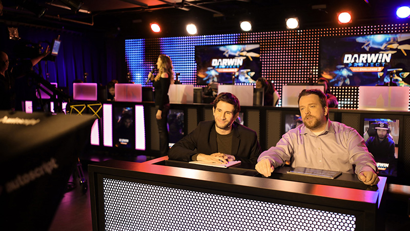 Two hosts speak to a live camera in the Esports and Gaming Studio.
