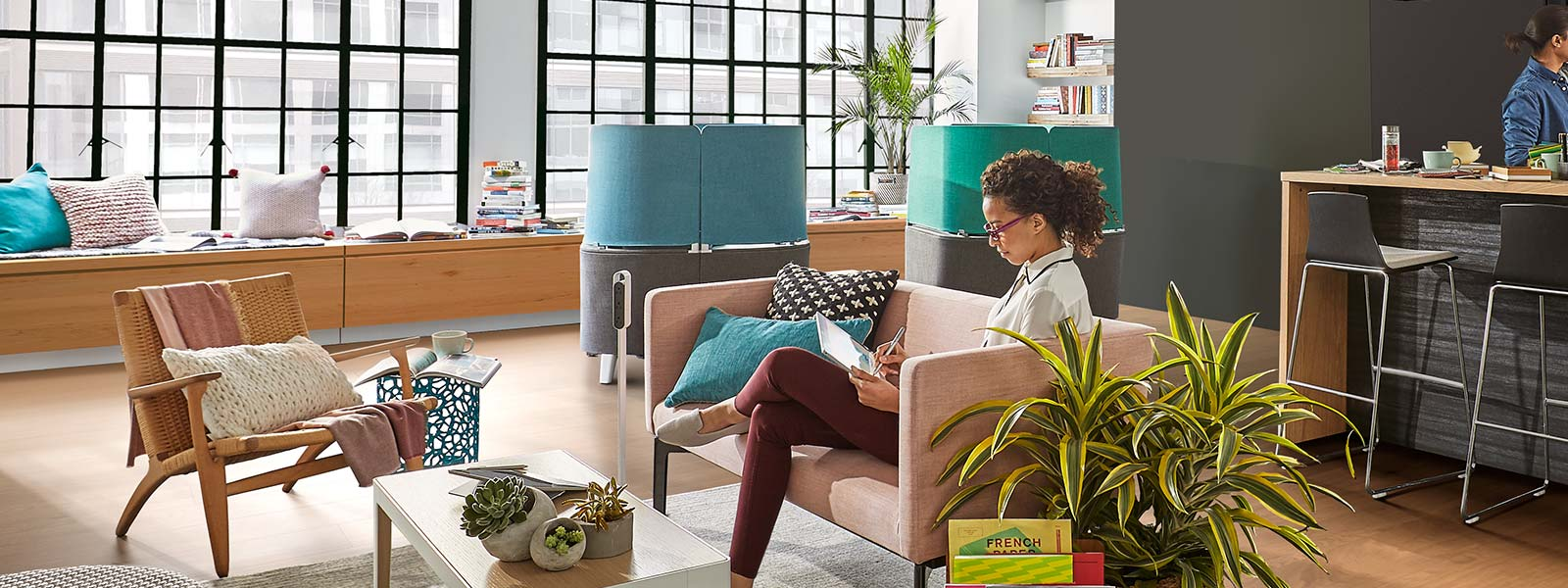 Steelcase space with people using Surface devices.